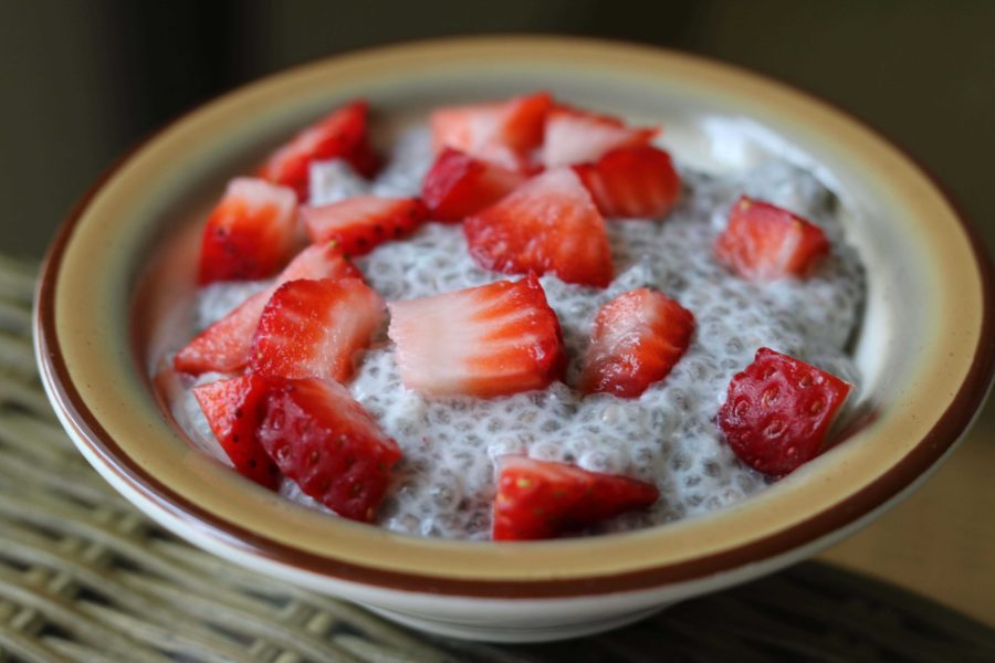 Cubed strawberry garnishing a bowl of tapioca-esque chia seed pudding