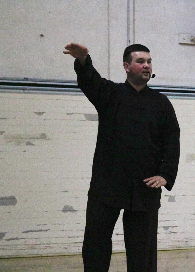 Shifu Justin Eggert instructs his students in breathing and balance techniques to deepen their understanding of how to move freely and maintain their center of gravity.
