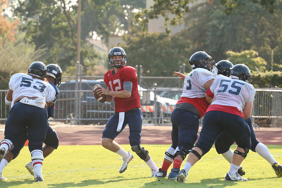 SRJC sophomore starting quarterback Mitch Hood scans the field during a team scrimmage Aug. 20.