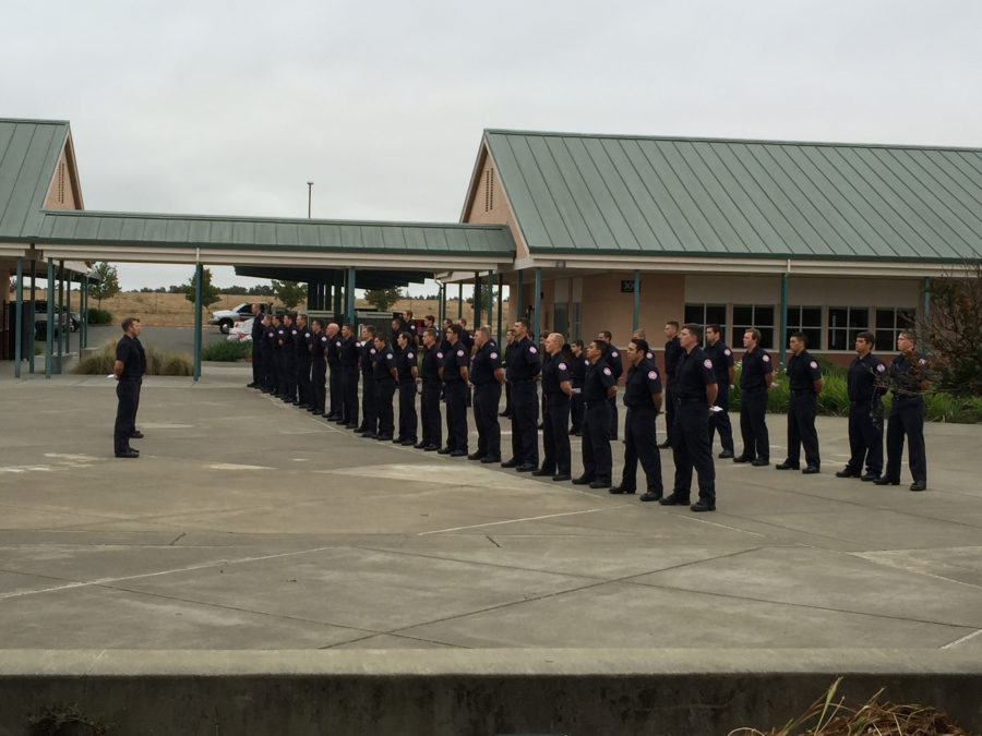 SRJC firefighter trainees stand at attention during the reading of the names of fallen firefighters on Sunday Sept. 11.