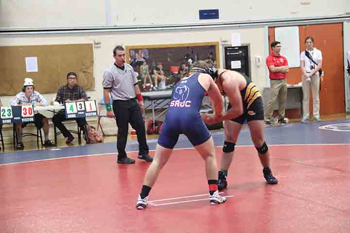SRJC+sophomore+wrestler+Paris+Henry+fights+for+position+in+his+winning+match+against+a+Chabot+College+wrestler.
