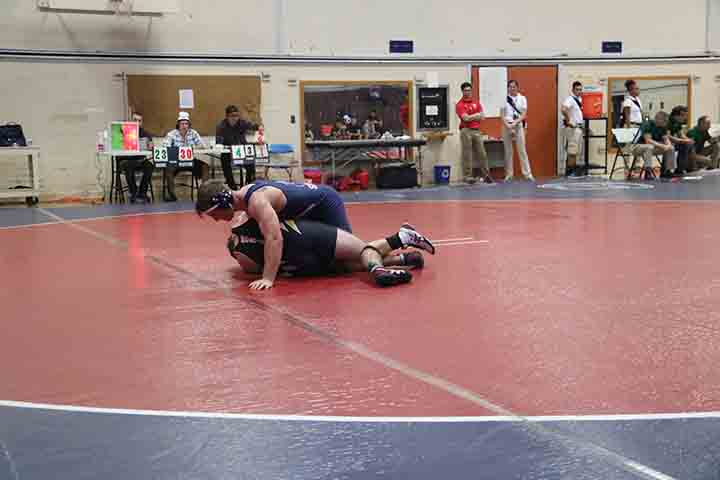 Paris Henry drops his opponent from Chabot College and maneuvers to get him pinned.
