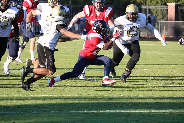 Santa Rosa Junior College running back Ja'Narrick James cuts through two San Joaquin Delta defensive players in a blowout 55-23 SRJC victory Sept. 17 at Bailey Field.