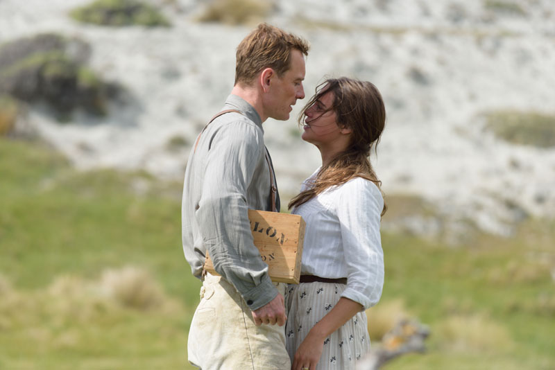 """Actors Michael Fassbender and Alicia Vikander share an intimate moment as they fall in love in """"The Light Between Oceans,"""" a film based on a novel by M.L. Steadman."""