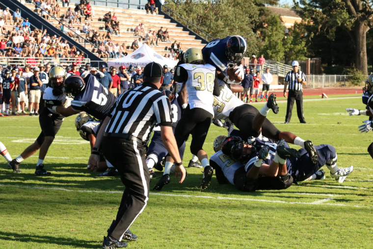 SRJCs Jay Ferguson leaps over the pile at the goal line to score a touchdown on a one yard run at Bailey Field.