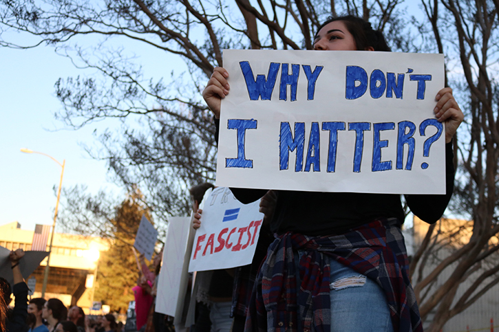 Community members advocate for minorities and protest possible consequences of Donald Trump's presidential win at last Thursday's rally at Santa Rosa City Hall.