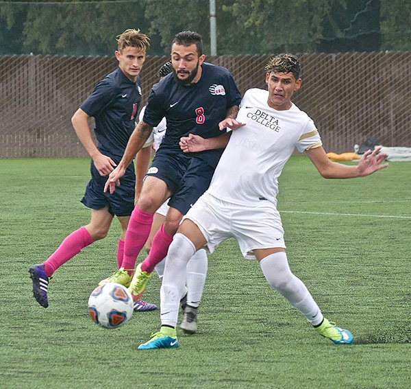 SRJC midfielder Henrique Noujeimi fights through opponent and attempts to steal the ball in the Bear Cubs 3-1 victory on Oct. 28.