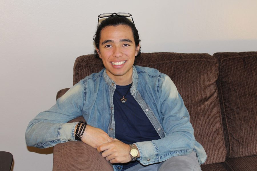 Sam Parilla relaxes on a couch, Parilla is one of 15 students in the exchange program this year.