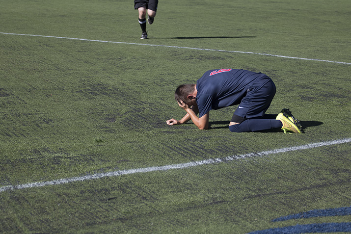 SRJC+freshmen+midfielder+Tony+Holleran+cradles+his+head+after+colliding+with+an+opponent+on+Aug+30.