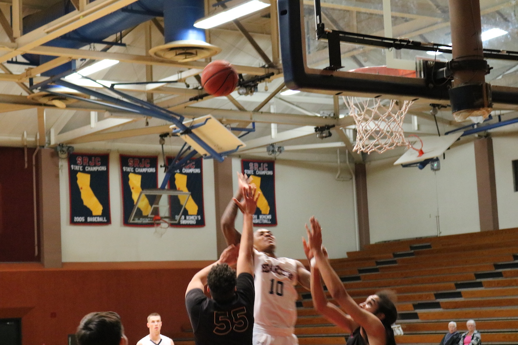 Justin Frazier drives to the basket