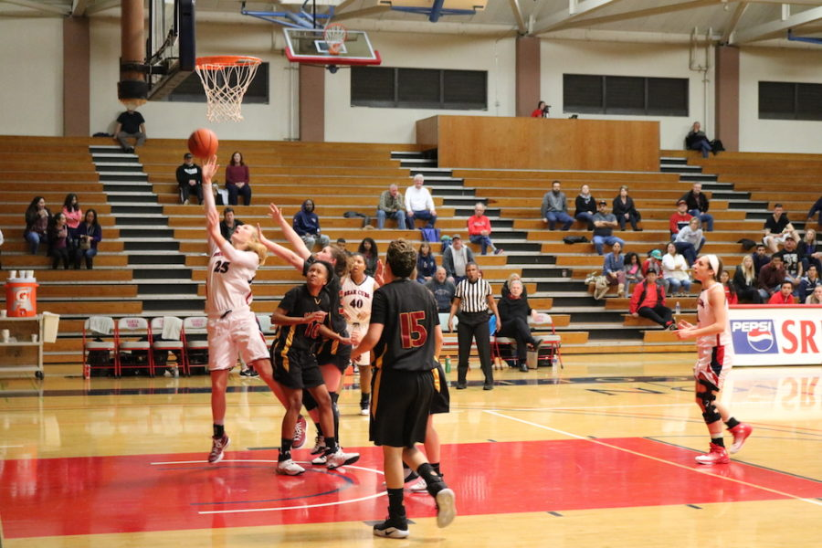 Tiffany Salinas doing work in in the paint