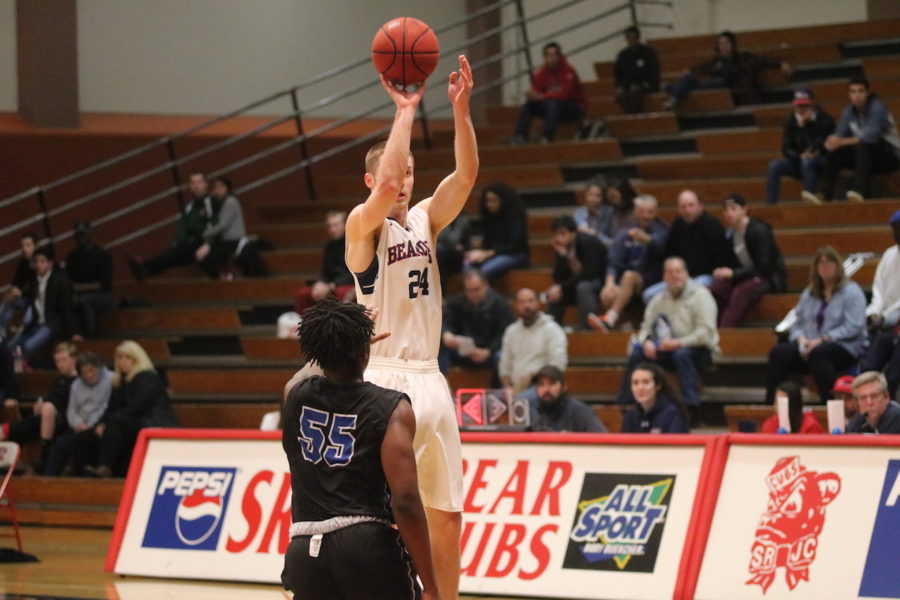 Sophomore guard Kiel Long shooting a basket from behind the arc
