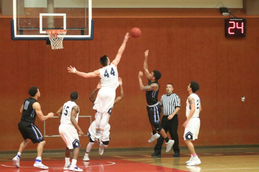 Sophomore forward Jon Montez blocking a shot