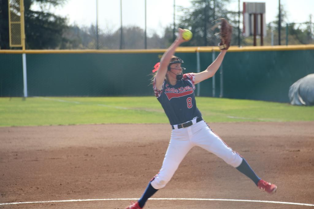 Sophomore pitcher Cailyn Callison winds up for a pitch to a Sierra College batter.