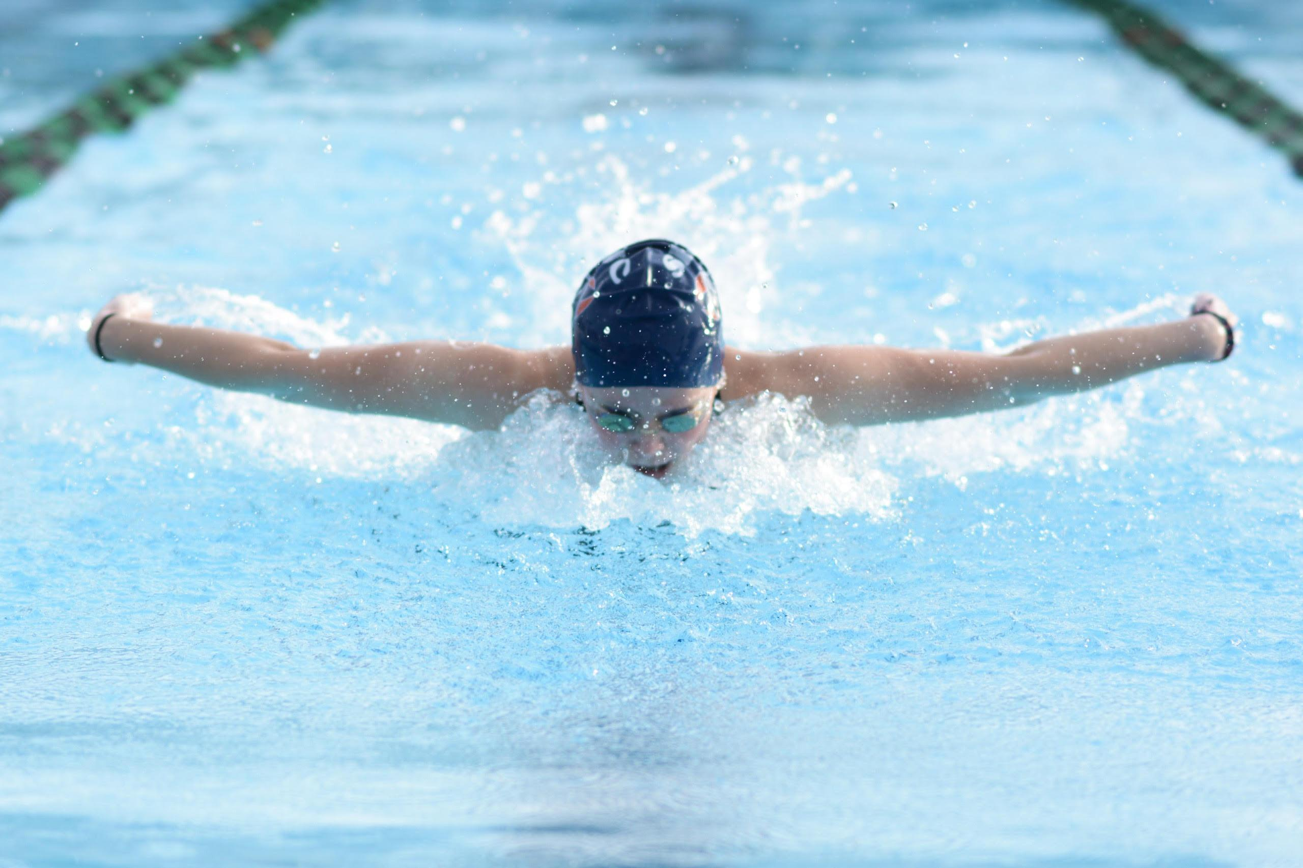 SRJC swimmer Taylor Sargis leaps out of the water mid butterfly stroke during the Cuesta Invitational March 11.