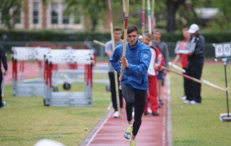 Adam Gockel approaches the mark for pole vault.