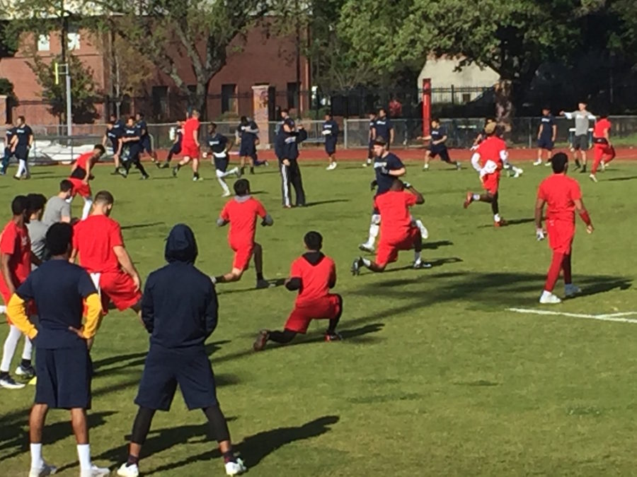 SRJC+football+warms+up+before+competing+against+each+other+in+the+2017+Spring+Olympics.