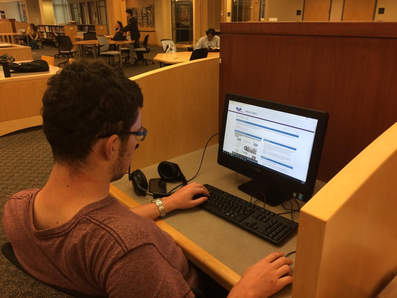 SRJC student Cameron Gordon-Miller, 20, signs up for his free digital subscription to the NY Times. Available for all SRJC students.