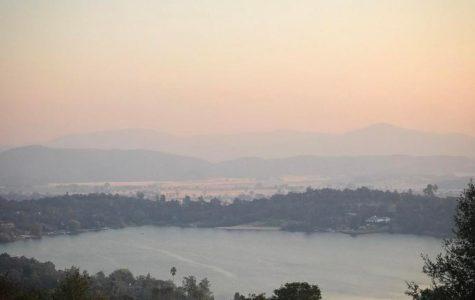 Smoke lies thick over Hidden Valley Lake, CA. Photo by David Andersen, @davidxandersen.