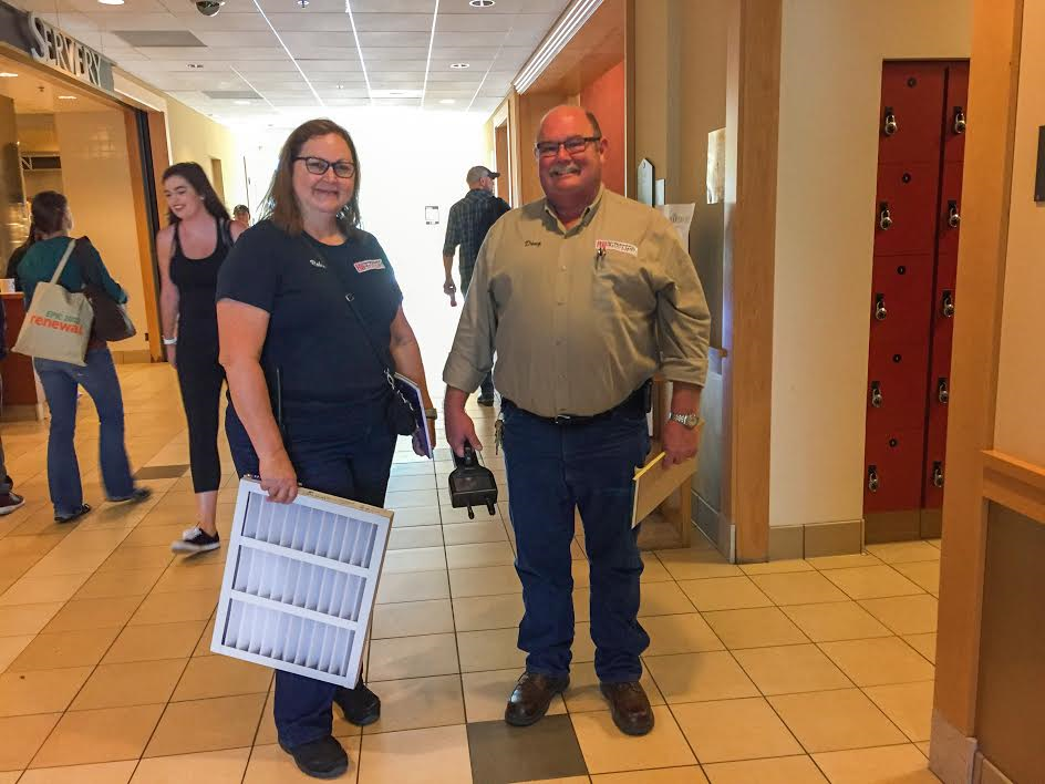 Santa Rosa Junior College Environmental Health and Safety staff, Robin McHalle and Doug Kuula, work hard to change filters and monitor air quality. PC Roberta MacIntyre