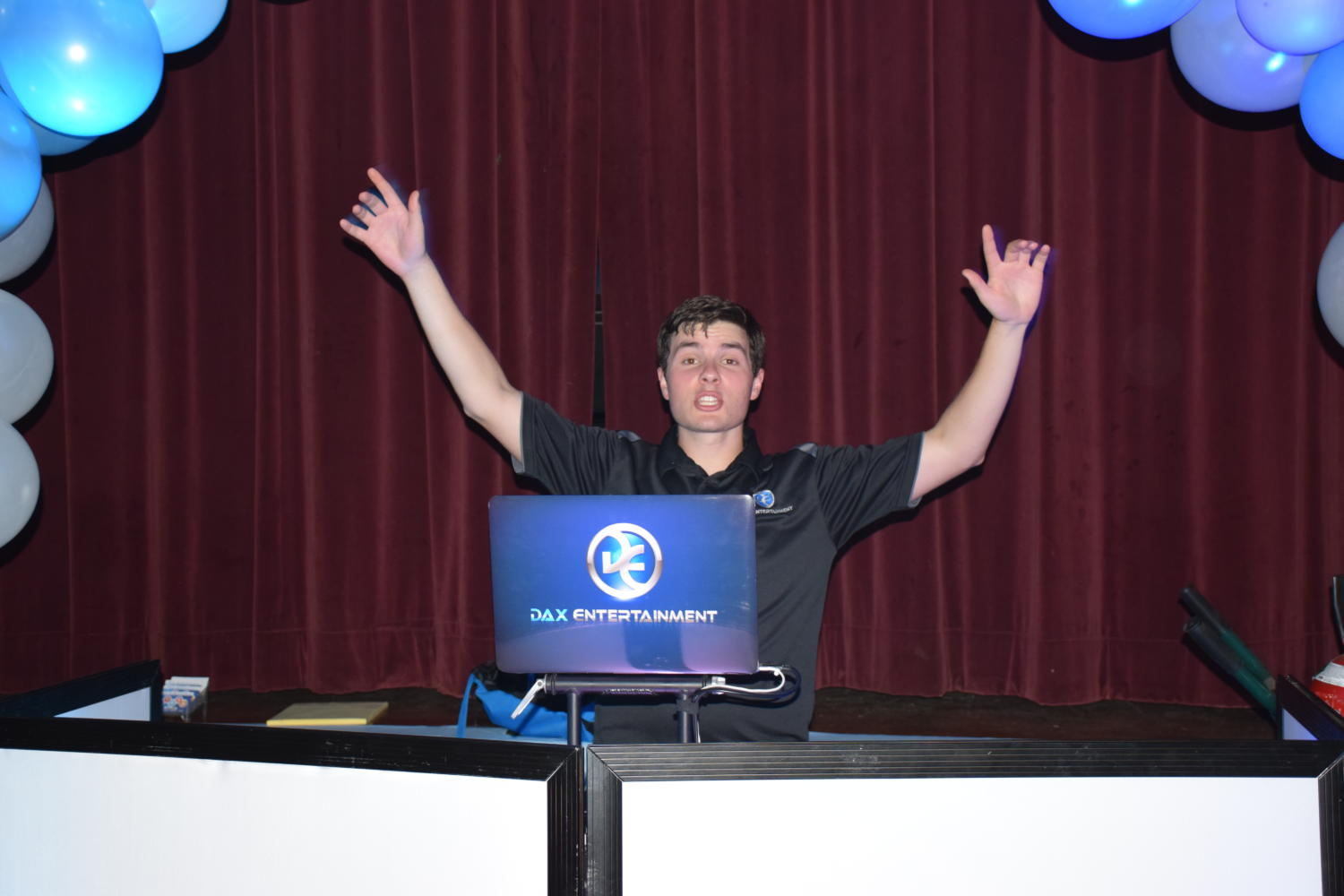 DJ Dustin having a blast behind the turntables as he prepares for a show.