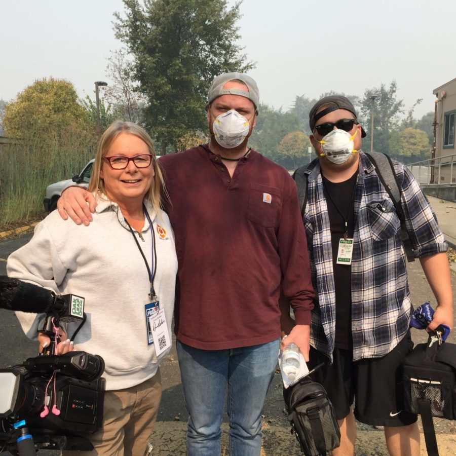 Roberta MacIntyre, James Wyatt and Albert Gregory don their N95 masks to travel bravely into the fire zones and capture footage. PC  Oak Leaf Staff