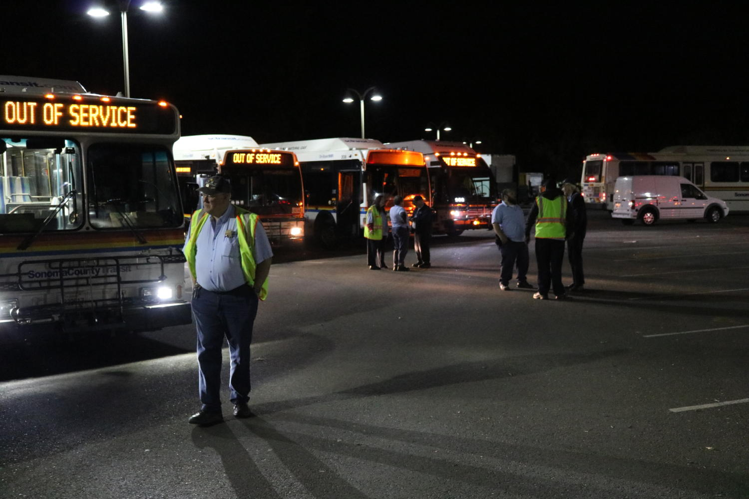 Evacuation buses roll into Sonoma State University as precautionary measures for students.