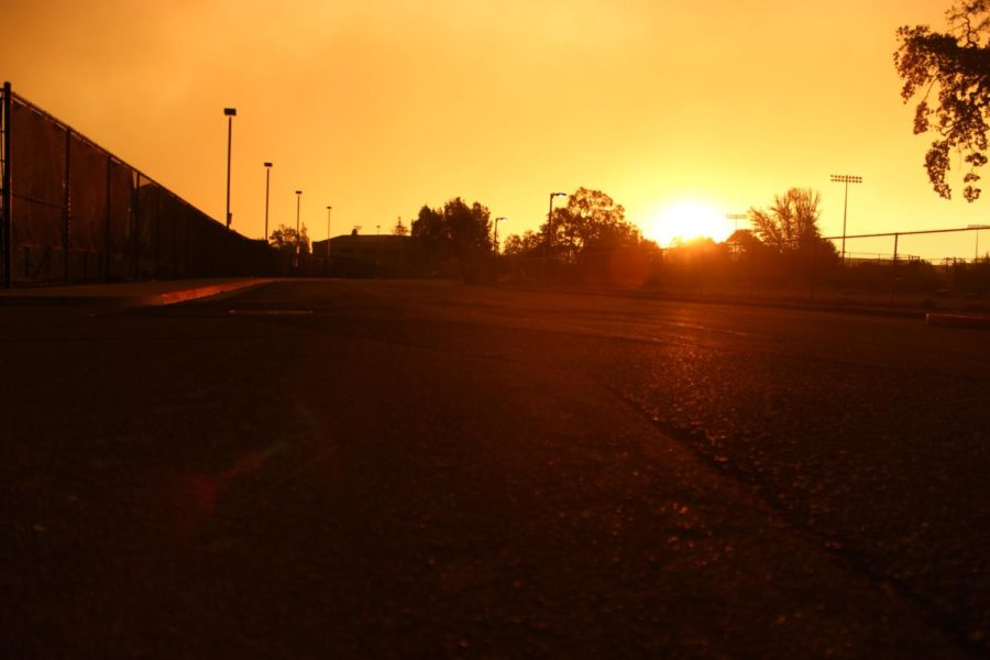 The sun rises over a smoky sky at SRJC on Monday Oct. 9.