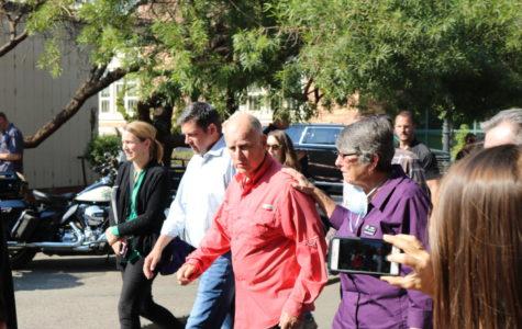 Governor Jerry Brown walks into the Santa Rosa High School gym to address the community with Senator Diane Feinstein and Senator Kamala Harris.