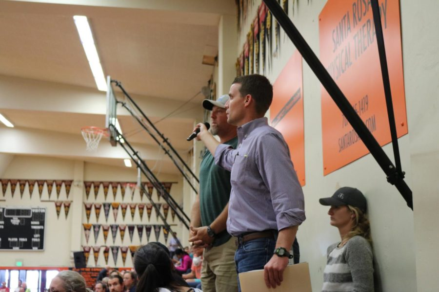 Senator Mike McGuire ran all over the Santa Rosa High School gym offering the microphone to community members who had pressing questions for emergency officials on Oct. 14.