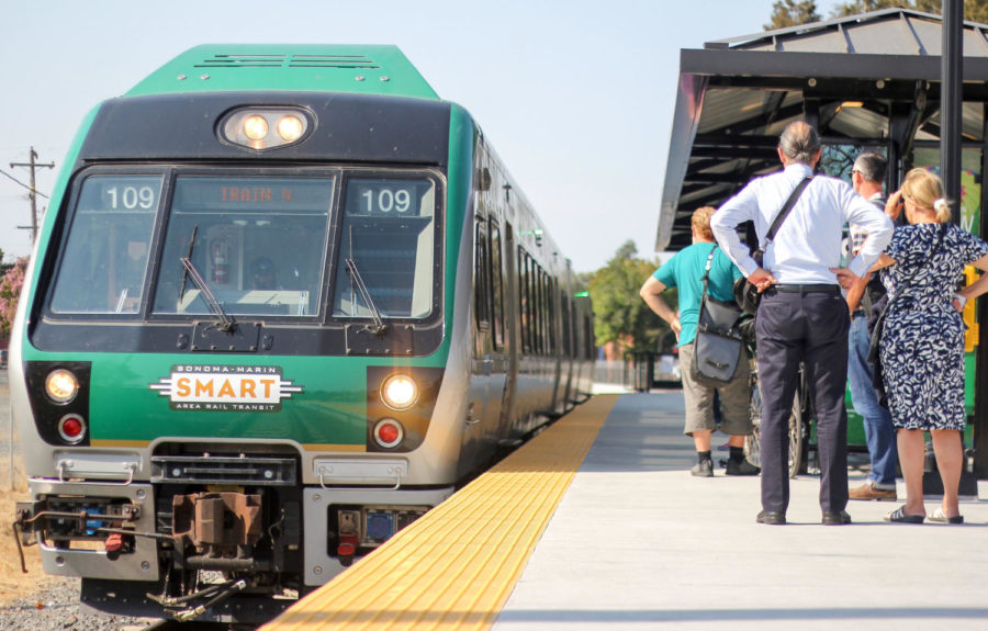 SMART train officials direct passengers to their designated trains.