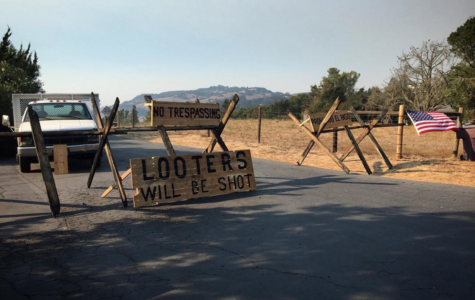 A sign warns looters in Sonoma County