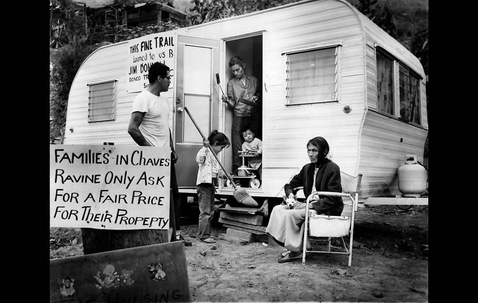 May 13, 1959: After having their homes destroyed by bulldozers, Chavez Ravine residents Manuel Augustine, left, Ivy Augustine (sweeping), Ira Augustine (baby), Victoria Augustine (woman in doorway) and Abrana Arechiga lived in a trailer.