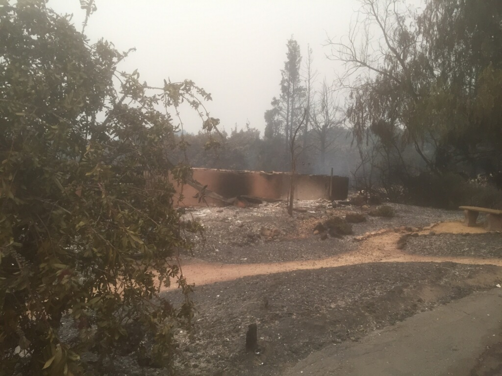 The charred remains of SRJC adjunct instructor, Ty Benoit's home, in the Wikiup area of Santa Rosa.