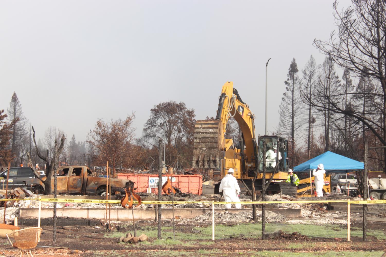 Clean-up crews use heavy machinery at Coffey Park Nov. 14.