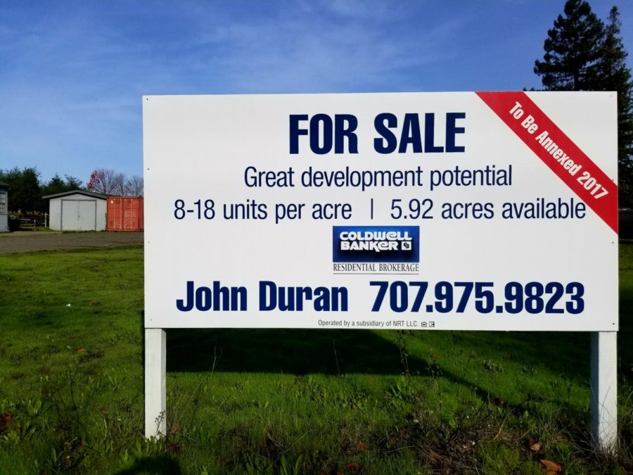 A+real+estate+sign+on+Sebastopol+Road%2C+touting+the+recent+annexation+of+Roseland+as+a+selling+point.