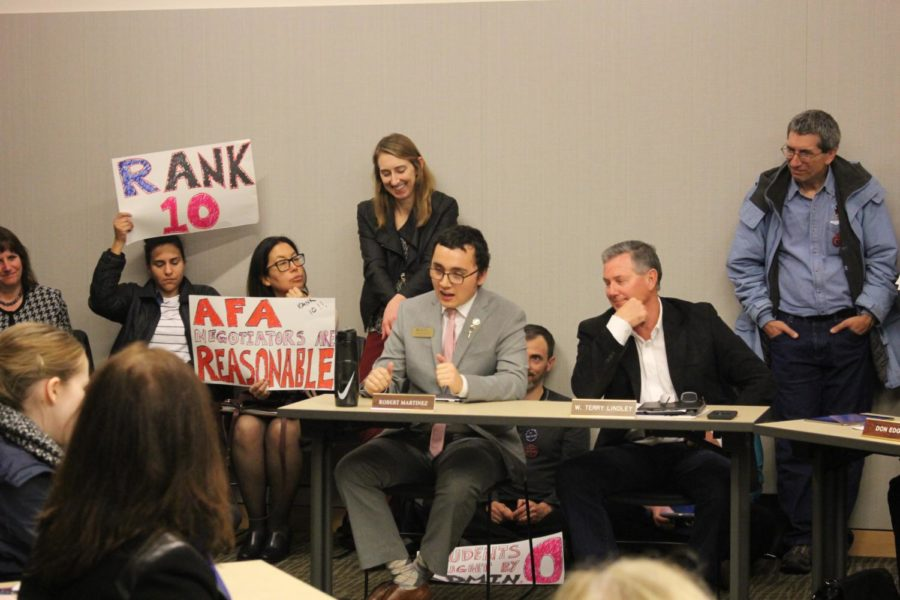 Student Trustee Robert Martinez (center) speaks in favor of adoption, citing the need to provide more assistance to disenfranchised students and reduce confusion and length of enrollment.