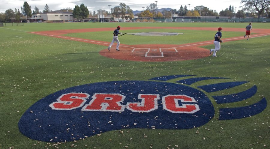 SRJC+baseball+players+sprint+across+the+diamond.
