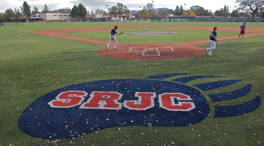 SRJC baseball players sprint across the diamond.