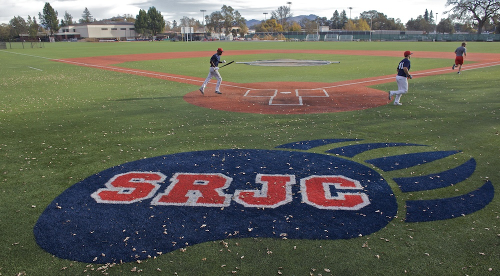 SRJC baseball players sprint across the diamond.