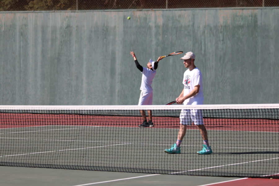 Second-year Andres Jojoa-Ortega serves as first-year Cade Stan readies up during their doubles match Tuesday.