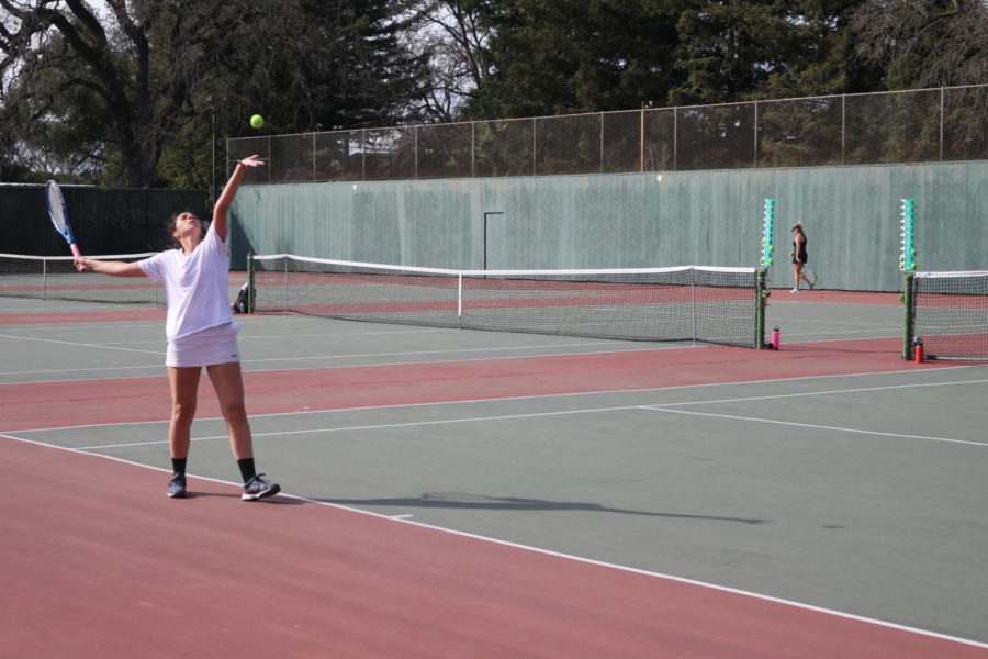 Second-year Elissa Papale serves during her singles victory Tuesday.