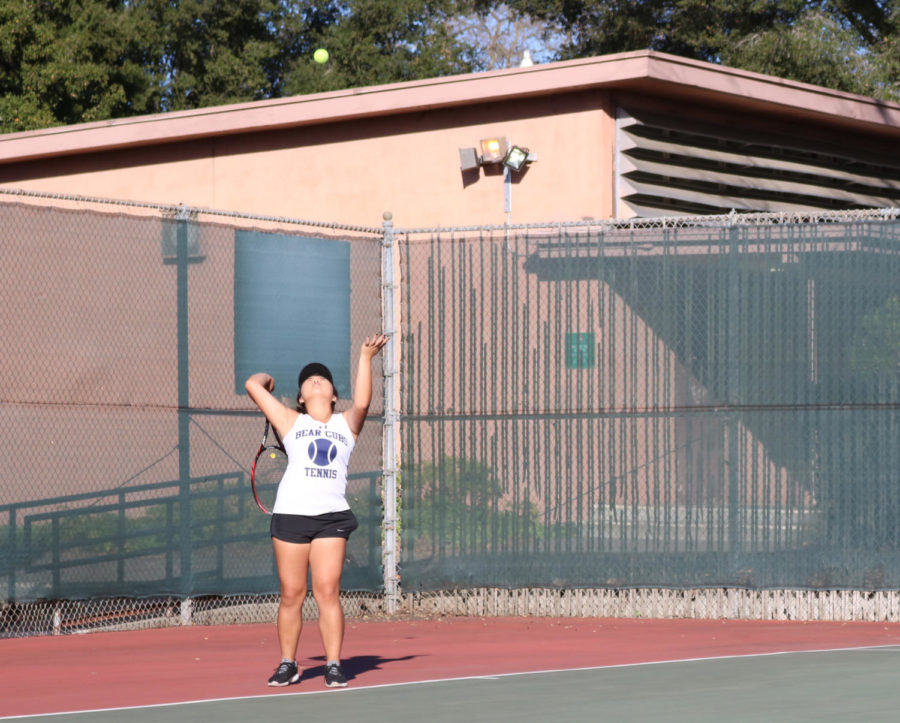Second-year Thu Dang serves during her 6-0/6-0 win on against Foothill College Tues.