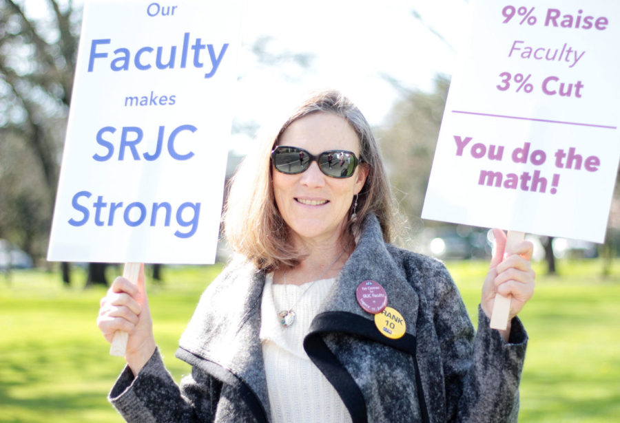 Chief AFA Negotiator Julie Thompson protests the unfair salary wages for faculty and staff on Mendocino Avenue.