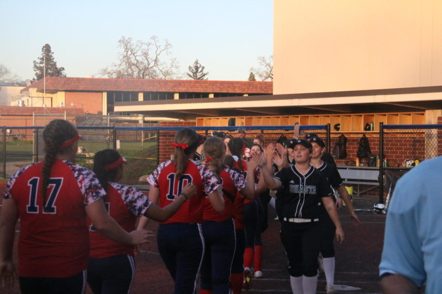 Both teams meet at home plate after the game.