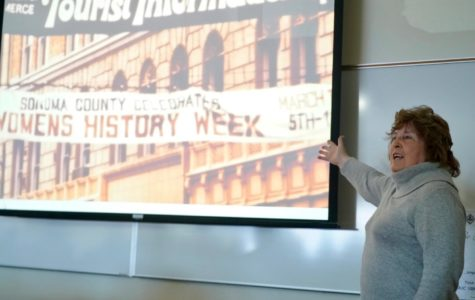 Molly McGregor presents a slideshow of images from the first Women's History Week in 1978 to students on Monday March 5. Photo by Rachel Edelstein.