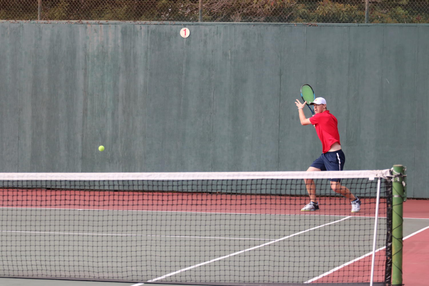 Second-year Trevor Pinder winds up for a rocket during his match Thursday.