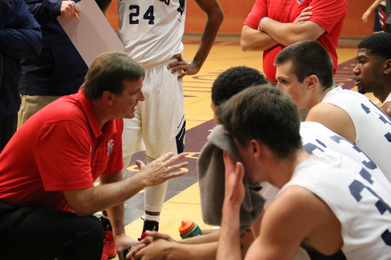 Head coach Craig McMilian focuses his team during a timeout.