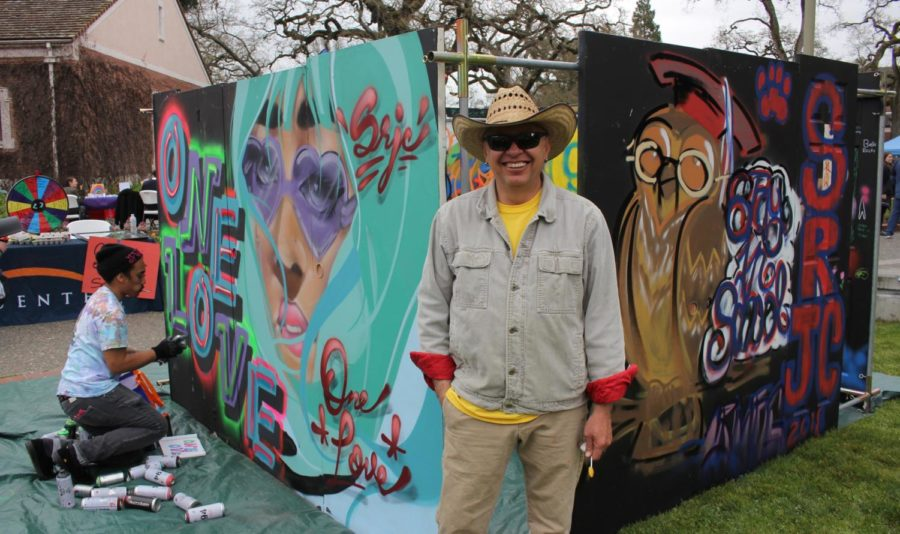 "Artist Martin Zuniga takes a break from screen printing to pose in front of his traveling art exhibit at SRJC's One Love Diversity Festival.  ""Since the market crash in 2008, it has been really tough for us artists. I started 'Quebo,' which means, 'What's up?' to take the art into the community. We bring it to schools or different events to make sure art gets to the people,"" said Zuniga. Photos by Adeira Sherpa."