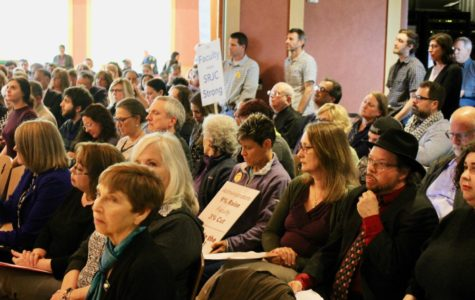 Crowds fill Bertolini Hall leaving standing room only during Tuesday's Board of Trustees meeting.